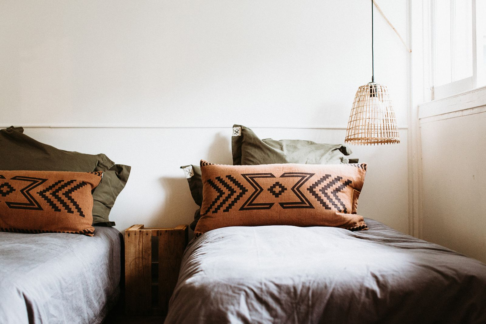 Mix it up with canvas bedding in charcoal and khaki and our reversible Seeker Cushion